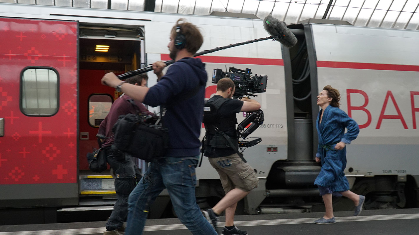 Jane birkin with film crew at zurich main station